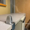 Adjustable counter partition clamp